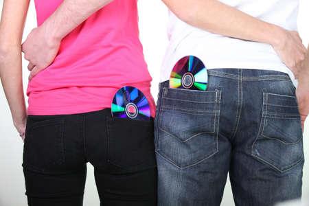 medium body: Discs CDs back pocket of jeans Stock Photo