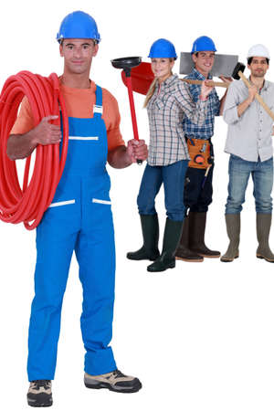 power shovel: Workers from different trades Stock Photo