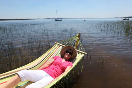 Woman in hammock by lake photo