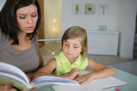 Mother and daughter reading together photo