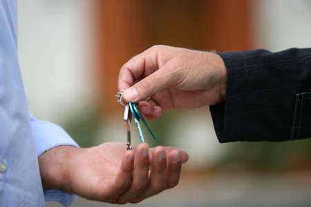 Estate agent handing over keys photo