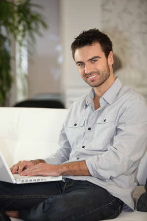 Man about to shop online Stock Photo