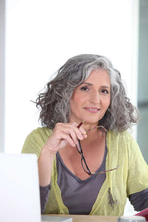 mature woman relaxing at home Stock Photo - 24249485