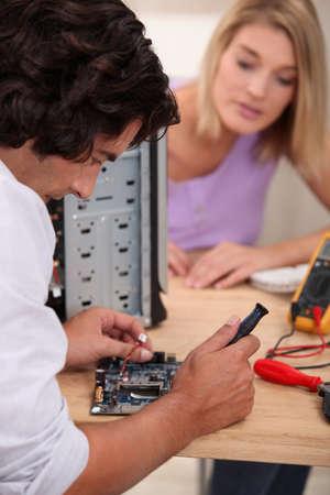 Computer repairing technician photo