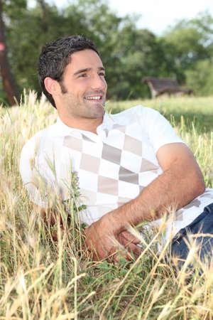 man lying in a field Stock Photo - 24256874