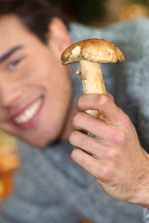Young showing mushroom photo