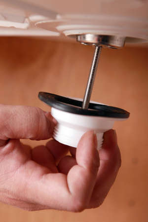 Plumber fixing sink plug Stock Photo - 24219111