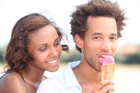 Couple with ice cream walking photo