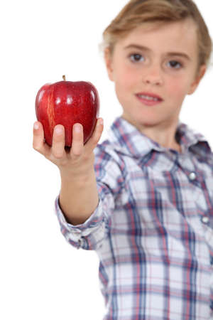arm extended: Girl with red apple
