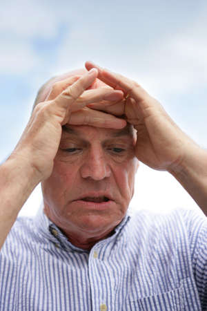 pain relief: Concerned old man Stock Photo