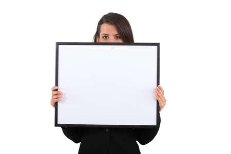 girl behind white frame Stock Photo - 24256930