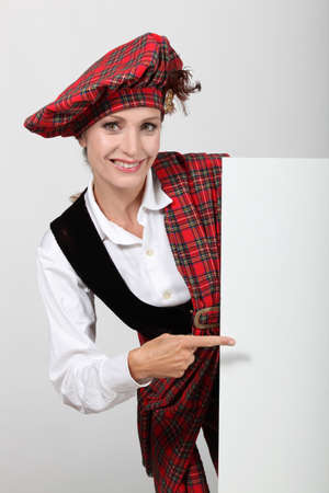Scottish woman pointing at white board Stock Photo - 24256932