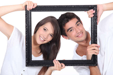 grabbing at the back: couple behind black frame