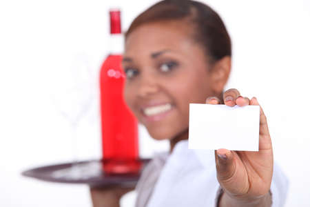 Waitress with a bottle photo