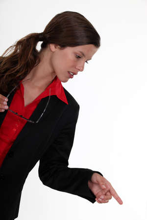 Businesswoman pointing photo