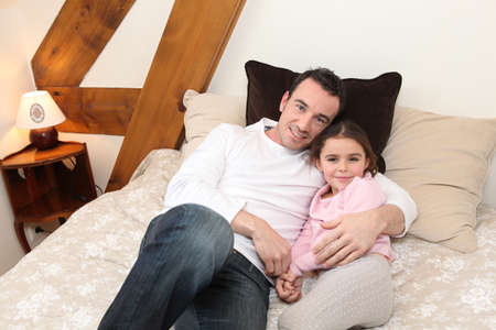 Father cuddling his daughter photo