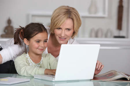 Mother and daughter with computer photo