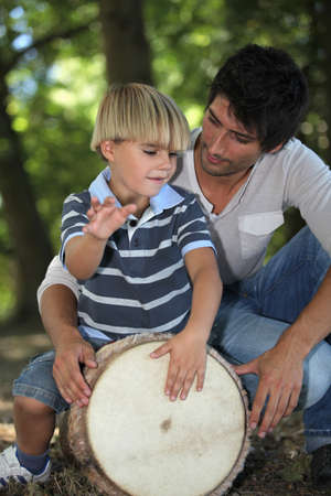 child beating drum photo