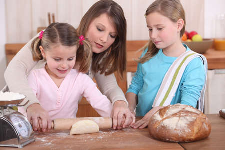 Mother and daughters baking photo