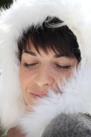Woman wearing coat with furry hood photo