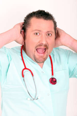 Doctor in scrubs shouting to be heard photo