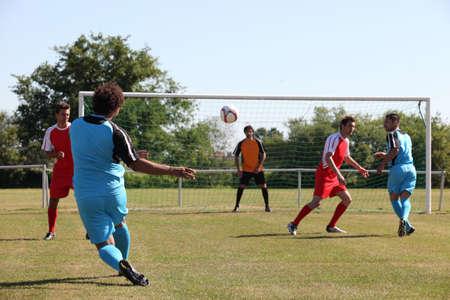 group goals: Footballer hoping for a goal Stock Photo