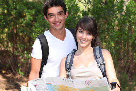 Young couple orienteering Stock Photo - 24257128