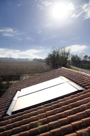 gelio: Sun shining onto solar panel Stock Photo