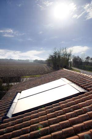 gelio: Sun shining onto solar panel Stock Photo