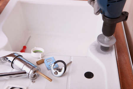 competences: a sink and plumbing pieces and tools