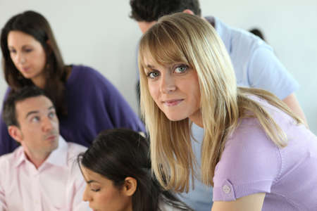 studygroup: Young blond woman in studygroup