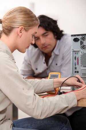 assembling: female computer technician Stock Photo
