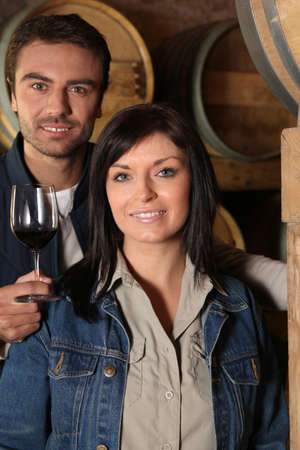 young couple tasting wine in their cellars photo