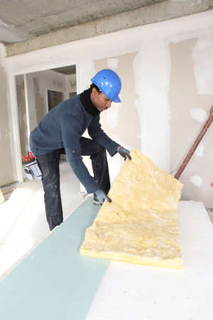 efficient: Construction worker with wall insulation