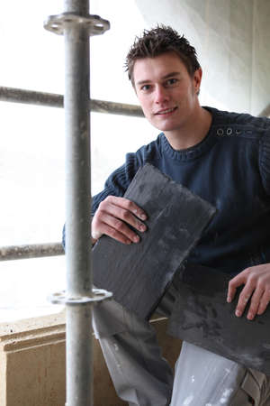 Roofer with slate tiles photo