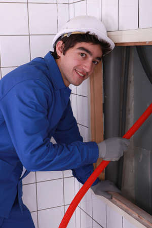 plumber happy to work photo