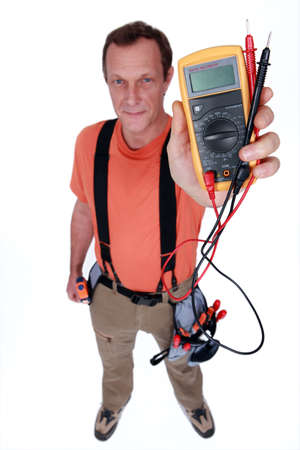 readout: Electrician holding a voltmeter