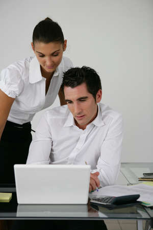 entrepreneurs: Two colleagues looking at laptop screen Stock Photo