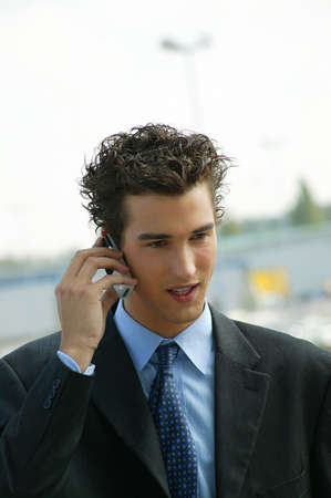 young businessman talking on his cell photo
