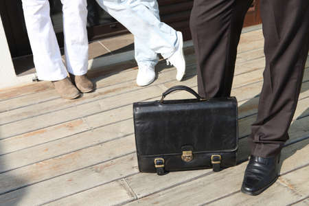 leather briefcase: Couple about to view property