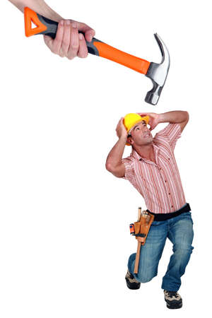 wimp: Construction worker being hit by a hammer Stock Photo