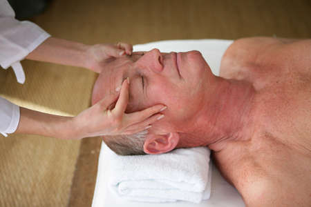 thalasso: senior man having a massage in a spa center Stock Photo