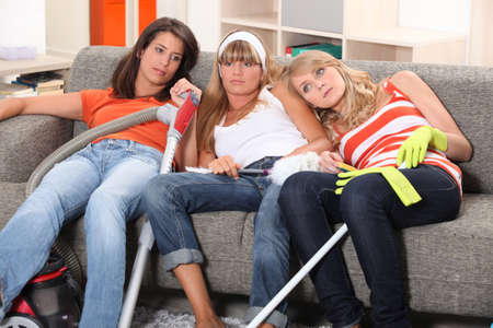 Girls relaxing after house-work Stock Photo