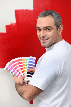 contrasting: Painter contrasting colors Stock Photo