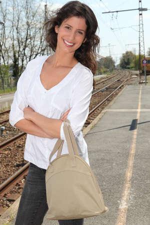 teethy: Woman on a train platform
