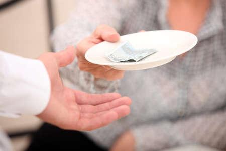 Customer handing money to waiter Stock Photo