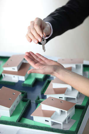 doorkey: Estate agent giving key to owner Stock Photo