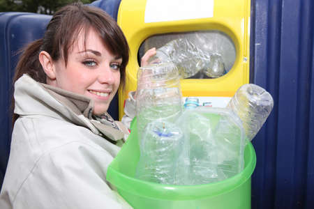 throw away: Young woman recycling plastic bottles