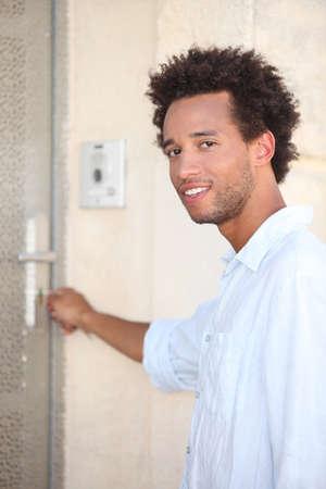 Young opening door photo