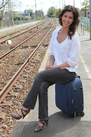 young woman at a train station photo